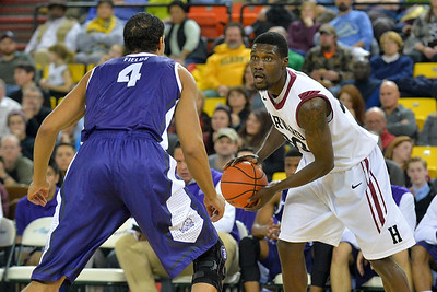 November 30, 2013: Harvard Crimson forward Kyle Casey (30) looks to drive against TCU Horned Frogs forward Amric Fields (4) in the championship game of the 2013 Great Alaska Shootout between Harvard and TCU. Harvard defeated TCU 71-50.