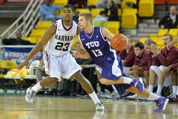 November 30, 2013: TCU Horned Frogs guard Christian Gore (13) drives past Harvard Crimson guard/forward Wesley Saunders (23) in the championship game of the 2013 Great Alaska Shootout between Harvard and TCU. Harvard defeated TCU 71-50.