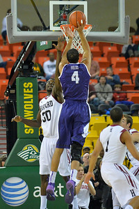 November 30, 2013: TCU Horned Frogs forward Amric Fields (4) shoots over Harvard Crimson forward Kyle Casey (30) in the championship game of the 2013 Great Alaska Shootout between Harvard and TCU. Harvard defeated TCU 71-50.