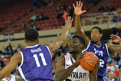 November 30, 2013: Harvard Crimson forward Kyle Casey (30) goes up against a pair of TCU Horned Frogs defenders in the championship game of the 2013 Great Alaska Shootout between Harvard and TCU. Harvard defeated TCU 71-50.