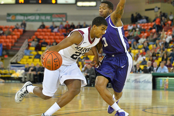 November 30, 2013: Harvard Crimson guard/forward Wesley Saunders (23) drives past TCU Horned Frogs guard Charles Hill Jr. (0) in the championship game of the 2013 Great Alaska Shootout between Harvard and TCU. Harvard defeated TCU 71-50.