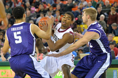 November 30, 2013: Harvard Crimson guard/forward Wesley Saunders (23) tries to escape the TCU Horned Frogs defense in the championship game of the 2013 Great Alaska Shootout between Harvard and TCU. Harvard defeated TCU 71-50.
