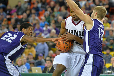 November 30, 2013: Harvard Crimson guard/forward Wesley Saunders (23) drives into the TCU Horned Frogs defense in the championship game of the 2013 Great Alaska Shootout between Harvard and TCU. Harvard defeated TCU 71-50.