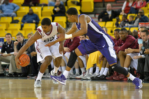 November 30, 2013: Harvard Crimson guard/forward Wesley Saunders (23) steals the ball from TCU Horned Frogs forward Brandon Parrish (11) in the championship game of the 2013 Great Alaska Shootout between Harvard and TCU. Harvard defeated TCU 71-50.