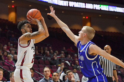 LAS VEGAS, NV - DECEMBER 22:  Trevelin Queen #20 of the New Mexico State Aggies shoots against Garrett Sturtz #3 of the Drake Bulldogs during their semifinal game of the Continental Tire Las Vegas Classic at the Orleans Arena in Las Vegas, Nevada.  (Photo by Sam Wasson for NM State Athletics)