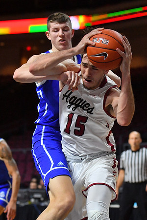 LAS VEGAS, NV - DECEMBER 22:  Ivan Aurrecoechea #15 of the New Mexico State Aggies grabs a rebound against the Drake Bulldogs during their semifinal game of the Continental Tire Las Vegas Classic at the Orleans Arena in Las Vegas, Nevada.  (Photo by Sam Wasson for NM State Athletics)