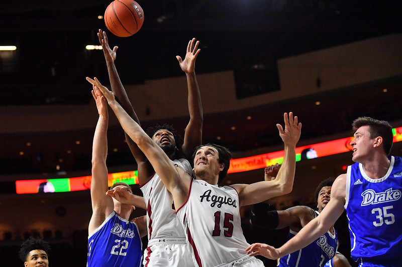 LAS VEGAS, NV - DECEMBER 22:  C.J. Bobbitt #13 and Ivan Aurrecoechea #15 of the New Mexico State Aggies battle Brady Ellingson #22 of the Drake Bulldogs for a rebound during their semifinal game of the Continental Tire Las Vegas Classic at the Orleans Arena in Las Vegas, Nevada.  (Photo by Sam Wasson for NM State Athletics)