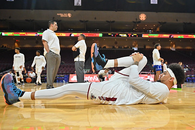 LAS VEGAS, NV - DECEMBER 22:  The Aggies warm up before their semifinal game of the Continental Tire Las Vegas Classic against the Drake Bulldogs at the Orleans Arena in Las Vegas, Nevada.  (Photo by Sam Wasson for NM State Athletics)