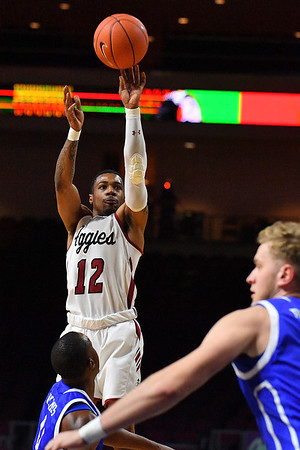 LAS VEGAS, NV - DECEMBER 22:  AJ Harris #12 of the New Mexico State Aggies shoots against D.J. Wilkins #0 of the Drake Bulldogs during their semifinal game of the Continental Tire Las Vegas Classic at the Orleans Arena in Las Vegas, Nevada.  (Photo by Sam Wasson for NM State Athletics)