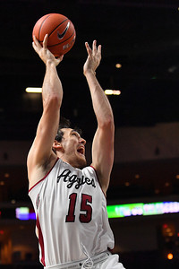 LAS VEGAS, NV - DECEMBER 22:  Ivan Aurrecoechea #15 of the New Mexico State Aggies shoots against the Drake Bulldogs during their semifinal game of the Continental Tire Las Vegas Classic at the Orleans Arena in Las Vegas, Nevada.  (Photo by Sam Wasson for NM State Athletics)