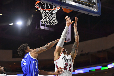 LAS VEGAS, NV - DECEMBER 22:  Eli Chuha #22 of the New Mexico State Aggies shoots against Anthony Murphy #4 of the Drake Bulldogs during their semifinal game of the Continental Tire Las Vegas Classic at the Orleans Arena in Las Vegas, Nevada.  (Photo by Sam Wasson for NM State Athletics)