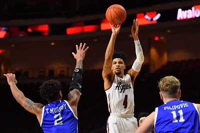 LAS VEGAS, NV - DECEMBER 22:  JoJo Zamora #4 of the New Mexico State Aggies shoots against Tremell Murphy #2 of the Drake Bulldogs during their semifinal game of the Continental Tire Las Vegas Classic at the Orleans Arena in Las Vegas, Nevada.  (Photo by Sam Wasson for NM State Athletics)