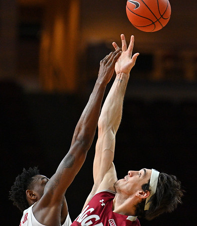 LAS VEGAS, NV - DECEMBER 23:  Ivan Aurrecoechea #15 of the New Mexico State Aggies and CJ Elleby #2 of the Washington State Cougars battle for the opening tip-off during the consolation game of the Continental Tire Las Vegas Classic at the Orleans Arena in Las Vegas, Nevada.  (Photo by Sam Wasson for NM State Athletics)