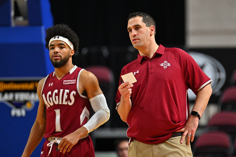 LAS VEGAS, NV - DECEMBER 23:  Assistant coach James Miller and Shunn Buchanan #1 of the New Mexico State Aggies stand on the court during the consolation game of the Continental Tire Las Vegas Classic against the  at the Orleans Arena in Las Vegas, Nevada.  (Photo by Sam Wasson for NM State Athletics)