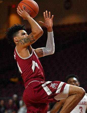 LAS VEGAS, NV - DECEMBER 23:  JoJo Zamora #4 of the New Mexico State Aggies shoots against the Washington State Cougars during the consolation game of the Continental Tire Las Vegas Classic at the Orleans Arena in Las Vegas, Nevada.  (Photo by Sam Wasson for NM State Athletics)