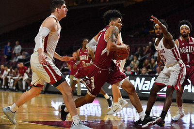 LAS VEGAS, NV - DECEMBER 23:  JoJo Zamora #4 of the New Mexico State Aggies drives against Ahmed Ali #23 of the Washington State Cougars during the consolation game of the Continental Tire Las Vegas Classic at the Orleans Arena in Las Vegas, Nevada.  (Photo by Sam Wasson for NM State Athletics)