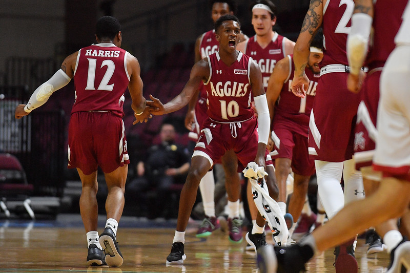 LAS VEGAS, NV - DECEMBER 23:  AJ Harris #12 and Jabari Rice #10 of the New Mexico State Aggies celebrate on the court in the first half during the consolation game of the Continental Tire Las Vegas Classic against the Washington State Cougars at the Orleans Arena in Las Vegas, Nevada.  (Photo by Sam Wasson for NM State Athletics)