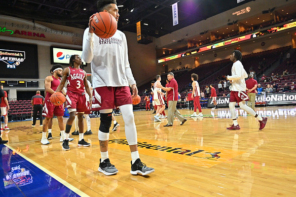 LAS VEGAS, NV - DECEMBER 23:  The Aggies warm up before the consolation game of the Continental Tire Las Vegas Classic against the Washington State Cougars at the Orleans Arena in Las Vegas, Nevada.  (Photo by Sam Wasson for NM State Athletics)