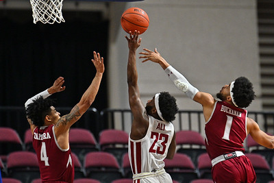 LAS VEGAS, NV - DECEMBER 23:  JoJo Zamora #4 and Shunn Buchanan #1 of the New Mexico State Aggies contest a shot from Ahmed Ali #23 of the Washington State Cougars during the consolation game of the Continental Tire Las Vegas Classic at the Orleans Arena in Las Vegas, Nevada.  (Photo by Sam Wasson for NM State Athletics)
