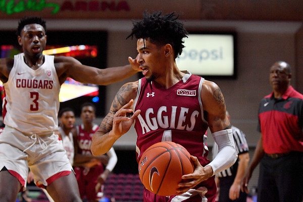 LAS VEGAS, NV - DECEMBER 23:  JoJo Zamora #4 of the New Mexico State Aggies dribbles against the Washington State Cougars during the consolation game of the Continental Tire Las Vegas Classic at the Orleans Arena in Las Vegas, Nevada.  (Photo by Sam Wasson for NM State Athletics)