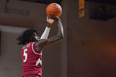 LAS VEGAS, NV - DECEMBER 23:  Clayton Henry #5 of the New Mexico State Aggies shoots against the Washington State Cougars during the consolation game of the Continental Tire Las Vegas Classic at the Orleans Arena in Las Vegas, Nevada.  (Photo by Sam Wasson for NM State Athletics)
