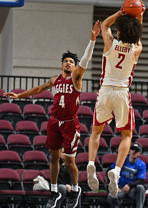 LAS VEGAS, NV - DECEMBER 23:  JoJo Zamora #4 of the New Mexico State Aggies contests a shot from CJ Elleby #2 of the Washington State Cougars during the consolation game of the Continental Tire Las Vegas Classic at the Orleans Arena in Las Vegas, Nevada.  (Photo by Sam Wasson for NM State Athletics)