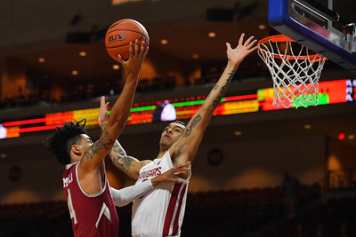 LAS VEGAS, NV - DECEMBER 23:  JoJo Zamora #4 of the New Mexico State Aggies shoots against Isaiah Wade #0 of the Washington State Cougars during the consolation game of the Continental Tire Las Vegas Classic at the Orleans Arena in Las Vegas, Nevada.  (Photo by Sam Wasson for NM State Athletics)