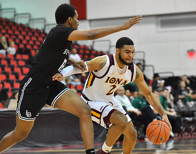 LAS VEGAS, NV - NOVEMBER 19:  E.J. Crawford #2 of the Iona Gaels drives against Breyon Jackson #12 of the Long Beach State 49ers during their middleweight bracket semifinal game of the MGM Resorts Main Event at Cox Pavilion in Las Vegas, Nevada.  (Photo by Sam Wasson for Iona Athletics)