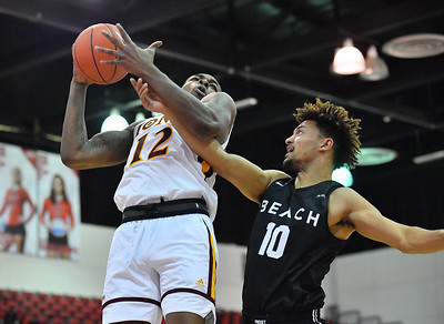 LAS VEGAS, NV - NOVEMBER 19:  Tajuan Agee #12 of the Iona Gaels grabs a rebound against Bryan Alberts #10 of the Long Beach State 49ers during their middleweight bracket semifinal game of the MGM Resorts Main Event at Cox Pavilion in Las Vegas, Nevada.  (Photo by Sam Wasson for Utah Valley Athletics)