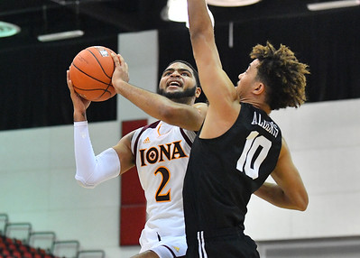 LAS VEGAS, NV - NOVEMBER 19:  E.J. Crawford #2 of the Iona Gaels shoots against Bryan Alberts #10 of the Long Beach State 49ers during their middleweight bracket semifinal game of the MGM Resorts Main Event at Cox Pavilion in Las Vegas, Nevada.  (Photo by Sam Wasson for Iona Athletics)