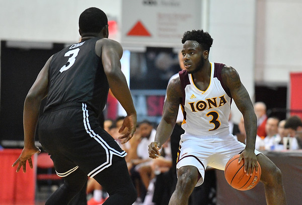LAS VEGAS, NV - NOVEMBER 19:  Asante Gist #3 of the Iona Gaels dribbles against Drew Cobb #3 of the Long Beach State 49ers during their middleweight bracket semifinal game of the MGM Resorts Main Event at Cox Pavilion in Las Vegas, Nevada.  (Photo by Sam Wasson for Iona Athletics)