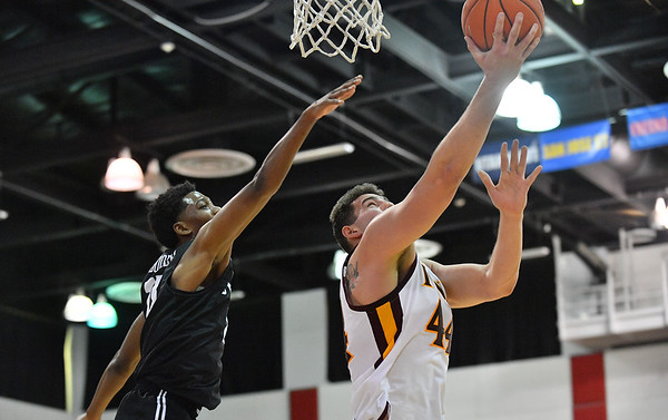 LAS VEGAS, NV - NOVEMBER 19:  Niksa Nikolic #44 of the Iona Gaels shoots against Deishuan Booker #15 of the Long Beach State 49ers during their middleweight bracket semifinal game of the MGM Resorts Main Event at Cox Pavilion in Las Vegas, Nevada.  (Photo by Sam Wasson for Utah Valley Athletics)