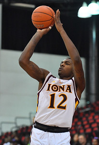 LAS VEGAS, NV - NOVEMBER 19:  Tajuan Agee #12 of the Iona Gaels shoots against the Long Beach State 49ers during their middleweight bracket semifinal game of the MGM Resorts Main Event at Cox Pavilion in Las Vegas, Nevada.  (Photo by Sam Wasson for Iona Athletics)