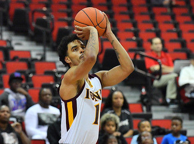 LAS VEGAS, NV - NOVEMBER 19:  Isaiah Still #1 of the Iona Gaels shoots against the Long Beach State 49ers during their middleweight bracket semifinal game of the MGM Resorts Main Event at Cox Pavilion in Las Vegas, Nevada.  (Photo by Sam Wasson for Iona Athletics)