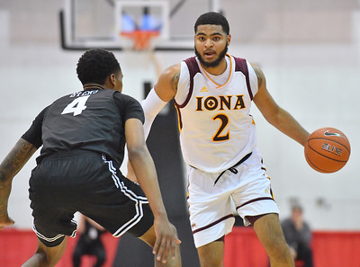 LAS VEGAS, NV - NOVEMBER 19:  E.J. Crawford #2 of the Iona Gaels dribbles against KJ Byers #4 of the Long Beach State 49ers during their middleweight bracket semifinal game of the MGM Resorts Main Event at Cox Pavilion in Las Vegas, Nevada.  (Photo by Sam Wasson for Iona Athletics)