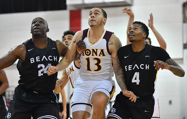 LAS VEGAS, NV - NOVEMBER 19:  Jahnathan Maxwell #13 of the Iona Gaels battles for rebounding position against Temidayo Yussuf #24 and KJ Byers #4 of the Long Beach State 49ers during their middleweight bracket semifinal game of the MGM Resorts Main Event at Cox Pavilion in Las Vegas, Nevada.  (Photo by Sam Wasson for Iona Athletics)