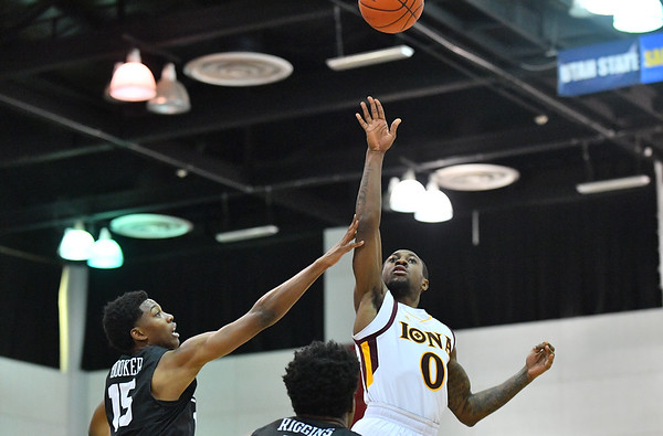 LAS VEGAS, NV - NOVEMBER 19:  Rickey McGill #0 of the Iona Gaels shoots against Deishuan Booker #15 of the Long Beach State 49ers during their middleweight bracket semifinal game of the MGM Resorts Main Event at Cox Pavilion in Las Vegas, Nevada.  (Photo by Sam Wasson for Utah Valley Athletics)