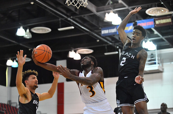 LAS VEGAS, NV - NOVEMBER 19:  Asante Gist #3 of the Iona Gaels shoots against Jordan Roberts #2 of the Long Beach State 49ers during their middleweight bracket semifinal game of the MGM Resorts Main Event at Cox Pavilion in Las Vegas, Nevada.  (Photo by Sam Wasson for Utah Valley Athletics)