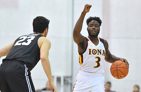 LAS VEGAS, NV - NOVEMBER 19:  Asante Gist #3 of the Iona Gaels dribbles against Edon Maxhuni #23 of the Long Beach State 49ers during their middleweight bracket semifinal game of the MGM Resorts Main Event at Cox Pavilion in Las Vegas, Nevada.  (Photo by Sam Wasson for Iona Athletics)