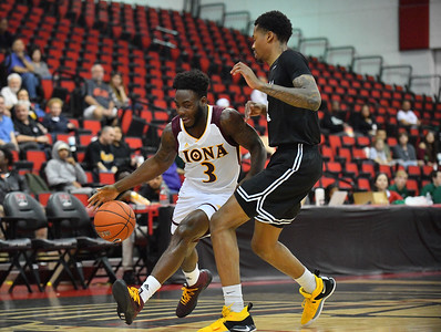 LAS VEGAS, NV - NOVEMBER 19:  Asante Gist #3 of the Iona Gaels dribbles against KJ Byers #4 of the Long Beach State 49ers during their middleweight bracket semifinal game of the MGM Resorts Main Event at Cox Pavilion in Las Vegas, Nevada.  (Photo by Sam Wasson for Utah Valley Athletics)