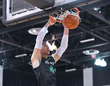 LAS VEGAS, NV - NOVEMBER 19:  Baylee Steele #44 of the Utah Valley Wolverines dunks against the Hartford Hawks during their middleweight bracket semifinal game of the MGM Resorts Main Event at Cox Pavilion in Las Vegas, Nevada.  (Photo by Sam Wasson for Utah Valley Athletics)