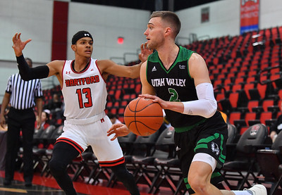 LAS VEGAS, NV - NOVEMBER 19:  Jake Toolson #2 of the Utah Valley Wolverines drives against J.R. Lynch #13 of the Hartford Hawks during their middleweight bracket semifinal game of the MGM Resorts Main Event at Cox Pavilion in Las Vegas, Nevada.  (Photo by Sam Wasson for Utah Valley Athletics)