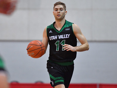 LAS VEGAS, NV - NOVEMBER 19:  Conner Toolson #11 of the Utah Valley Wolverines brings the ball up the courrt against the Hartford Hawks during their middleweight bracket semifinal game of the MGM Resorts Main Event at Cox Pavilion in Las Vegas, Nevada.  (Photo by Sam Wasson for Utah Valley Athletics)