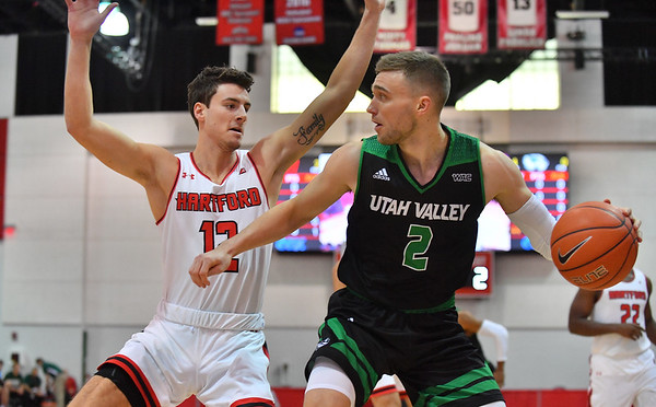 LAS VEGAS, NV - NOVEMBER 19:  Jake Toolson #2 of the Utah Valley Wolverines dribbles against Jason Dunne #12 of the Hartford Hawks during their middleweight bracket semifinal game of the MGM Resorts Main Event at Cox Pavilion in Las Vegas, Nevada.  (Photo by Sam Wasson for Utah Valley Athletics)