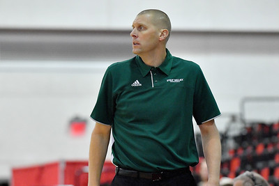 LAS VEGAS, NV - NOVEMBER 19:  Head coach Mark Pope of the Utah Valley Wolverines looks on during his team's middleweight bracket semifinal game of the MGM Resorts Main Event against the Hartford Hawks at Cox Pavilion in Las Vegas, Nevada.  (Photo by Sam Wasson for Utah Valley Athletics)