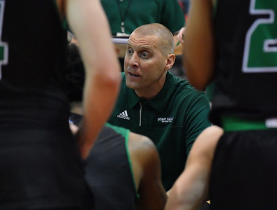 LAS VEGAS, NV - NOVEMBER 19:  Head coach Mark Pope of the Utah Valley Wolverines talks to his team during a timeout in their middleweight bracket semifinal game of the MGM Resorts Main Event against the Hartford Hawks at Cox Pavilion in Las Vegas, Nevada.  (Photo by Sam Wasson for Utah Valley Athletics)