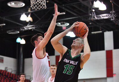 LAS VEGAS, NV - NOVEMBER 19:  Connor MacDougall #15 of the Utah Valley Wolverines shoots against Jason Dunne #12 of the Hartford Hawks during their middleweight bracket semifinal game of the MGM Resorts Main Event at Cox Pavilion in Las Vegas, Nevada.  (Photo by Sam Wasson for Utah Valley Athletics)