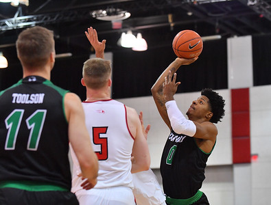 LAS VEGAS, NV - NOVEMBER 19:  Isaiah White #0 of the Utah Valley Wolverines shoots against John Carroll #5 of the Hartford Hawks during their middleweight bracket semifinal game of the MGM Resorts Main Event at Cox Pavilion in Las Vegas, Nevada.  (Photo by Sam Wasson for Utah Valley Athletics)
