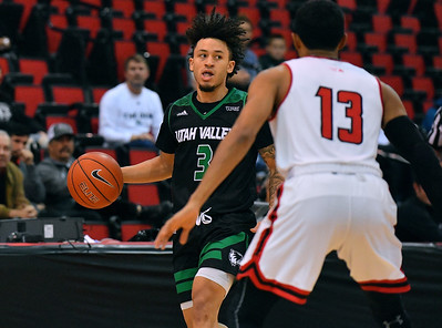 LAS VEGAS, NV - NOVEMBER 19:  TJ Washington #3 of the Utah Valley Wolverines dribbles against J.R. Lynch #13 of the Hartford Hawks during their middleweight bracket semifinal game of the MGM Resorts Main Event at Cox Pavilion in Las Vegas, Nevada.  (Photo by Sam Wasson for Utah Valley Athletics)