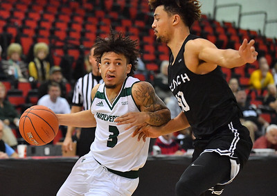 LAS VEGAS, NV - NOVEMBER 21:  TJ Washington #3 of the Utah Valley Wolverines drives against Bryan Alberts #10 of the Long Beach State 49ers during the middleweight bracket championship game of the MGM Resorts Main Event at Cox Pavilion in Las Vegas, Nevada.  (Photo by Sam Wasson for Iona Athletics)